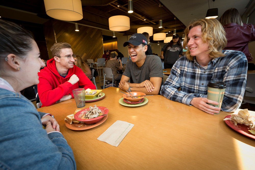 Students sitting at a table in the Cub Cafe